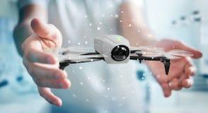 Biznesmen używa nowożytnego trutnia 3D rendering Zdjęcia Royalty Free