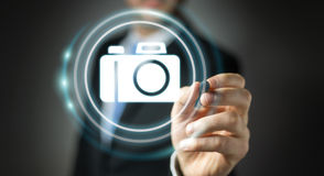 Biznesmen używa nowożytnej kamery podaniowego 3D rendering Obrazy Royalty Free