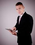 Biznesmen używa pastylka komputer osobistego. Obraz Royalty Free