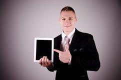 Biznesmen używa pastylka komputer osobistego. Obraz Stock