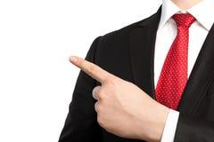 biznesmen w kostiumu i punktach palec przy objec obraz stock