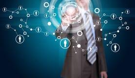 Biznesmen w kostiumu palcu naciska wirtualnego guzika Zdjęcie Royalty Free