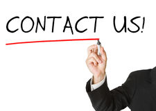 Biznesmen w kostiumu rysuje tekst 'kontakt my' zdjęcia stock
