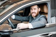 Biznesmen w luksusowym samochodzie zdjęcia royalty free