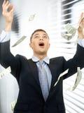 Biznesmen w pieniądze deszczu indoors Obrazy Royalty Free