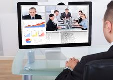 Biznesmen wideo konferencja z drużyną Zdjęcia Stock