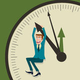 Biznesmen wiesza na strzała i zegar Zdjęcia Stock