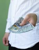 Biznesmen wręcza trzymać dolar gotówkę Zdjęcie Royalty Free
