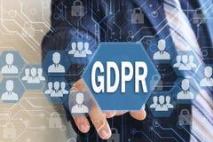 Biznesmen wybiera GDPR na dotyka ekranie Ogólnych dane ochrony Przepisowy pojęcie może 25, 2018 Zdjęcie Royalty Free
