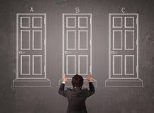 Biznesmen wybiera prawego drzwi Zdjęcie Stock
