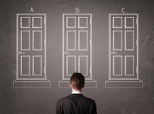 Biznesmen wybiera prawego drzwi Obrazy Royalty Free
