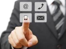 Biznesmen wybiera wirtualną kontaktową ikonę Fotografia Royalty Free