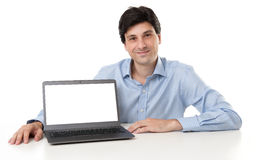 Biznesmen wystawia laptop Zdjęcia Stock