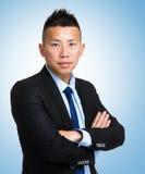 Biznesmen z błękitnym tłem Obraz Royalty Free