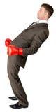 Biznesmen z bokserskich rękawiczek bronić zdjęcie stock