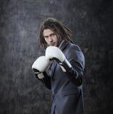 Biznesmen z bokserskimi rękawiczkami Zdjęcia Stock