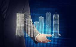 Biznesmen z 3d miasta liczbami i modelem Obraz Stock