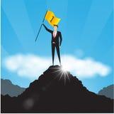Biznesmen z flaga na góra wierzchołku Zdjęcia Royalty Free