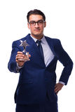 Biznesmen z gwiazdową nagrodą odizolowywającą na bielu Zdjęcie Stock