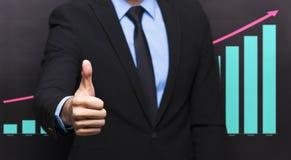 Biznesmen z kciukiem up gestykuluje Obrazy Royalty Free