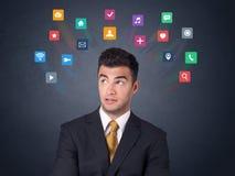 Biznesmen z kolorowymi apps Obrazy Royalty Free