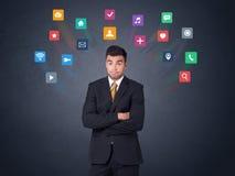 Biznesmen z kolorowymi apps Zdjęcia Royalty Free