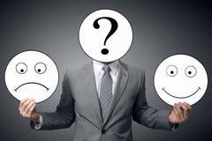 Biznesmen z maską różne emocje Biznesmena mienia uśmiech i smutna maska Konceptualny wizerunek mężczyzna zmienia jego nastrój f obraz royalty free