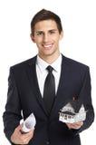 Biznesmen z modela projektem i domem Fotografia Stock