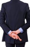 Biznesmen z palcami krzyżującymi. Zdjęcie Royalty Free