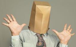Biznesmen z papierową torbą na jego głowie zdjęcie stock