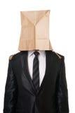 Biznesmen z papierową torbą nad jego głową obraz royalty free