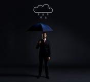 Biznesmen z parasolem pod deszczem Obrazy Stock