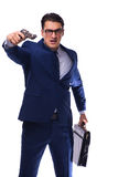 Biznesmen z pistoletem odizolowywającym na bielu Obraz Stock