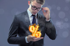 Biznesmen z procentem podpisuje wewnątrz wysokiego interesu pojęcie Zdjęcia Stock