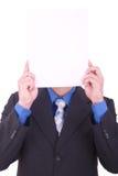 Biznesmen z pustym papierem w jego twarzy Obrazy Royalty Free