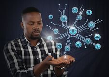 Biznesmen z ręki palmą otwartą i różnorodnym biznesowym ikona interfejsem Zdjęcie Stock