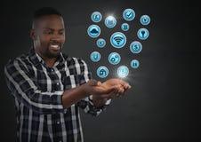 Biznesmen z ręki palmą otwartą i różnorodnymi biznesowymi ikonami Obrazy Stock