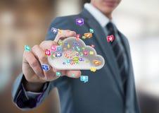 biznesmen z ręki rozszerzaniem się brać chmurę z podaniowymi ikonami Biznesu zamazany tło Zdjęcia Royalty Free