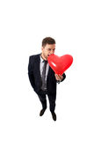Biznesmen z serce kształtującym balonem Obrazy Stock