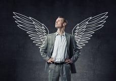 Biznesmen z skrzydłami fotografia stock