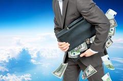Biznesmen z walizką pełno pieniądze Fotografia Royalty Free