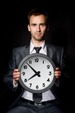 Biznesmen z zegarem Obrazy Royalty Free