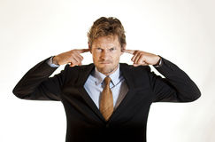 Biznesmen zakrywa jego ucho zdjęcie royalty free