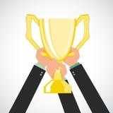 Biznesmen zespala się trzymający mistrza złota trofeum Zdjęcie Royalty Free