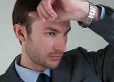 Biznesmen zgina jego ręka Zdjęcie Royalty Free
