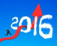 Biznesmena bieg na strzałkowatej tendenci wzrostowej linii przez 2016 clou zdjęcie stock