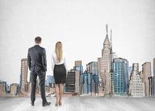 Biznesmena bizneswoman patrzeje miasta nakreślenie obraz stock