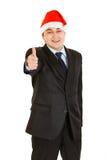 biznesmena bożych narodzeń kapeluszowy seans kciuk kapeluszowy Fotografia Royalty Free