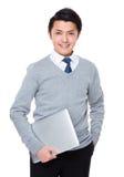 Biznesmena chwyt z laptopem Zdjęcia Stock