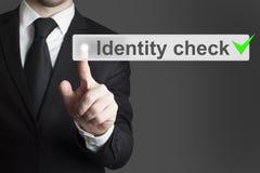 Biznesmena dosunięcia guzika tożsamości czek Fotografia Royalty Free